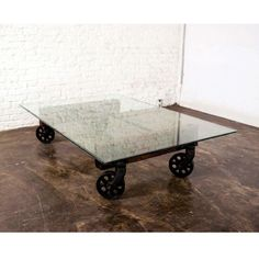 Nuevo V35 Rectangle Glass Top Coffee Table with Wheels | from hayneedle.com