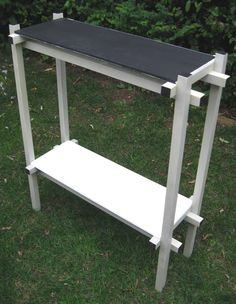 Gerrit Rietveld De Stijl painted side table with black & white shelves