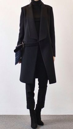 All Black. Not the Kiwi's Rugby team, but this easy to adapt style. Looks modern, strong, sophisticated. Love the suede boots, make the look less stiff. Not a big fan of the coat-belt, would have choose either no belt or black ones.
