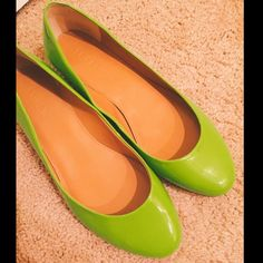 """J. Crew Patent Italian Leather Flats Size 6.5 Lime green (""""Citrus"""") patent flats. Leather made in Italy.  A perfect pop of color. They're nice and glossy and the gold heel is very shiny.  Very good condition! They're true to size, which is just a bit small for me. Only worn 1-2 times. Notice small brown scuff in fourth photo; it's on the inside and not noticeable at all when worn! I haven't worked on it, so could potentially be removed :) J. Crew Shoes Flats & Loafers"""