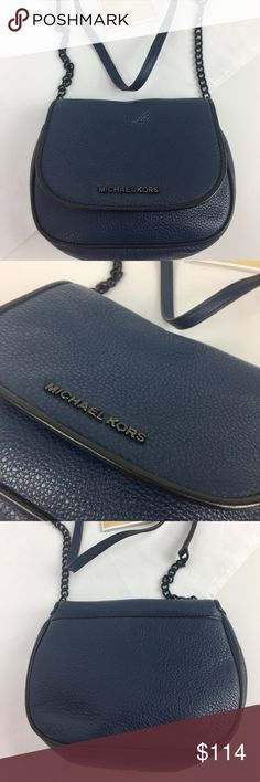 """Michael Kors  French Binding Leather Crossbody Condition: Gently loved. Grade A condition inside and out.  Pebbled navy leather with black leather trim. Black tone hardware. Exterior back slide in pocket, 1 slip pocket interior. Flap top with magnetic closure. Adjustable crossbody strap with 21"""" drop. 5.5"""" H x 7"""" W x 3"""" D.     Thank you for your interest! No Trades please. Michael Kors Bags Crossbody Bags"""