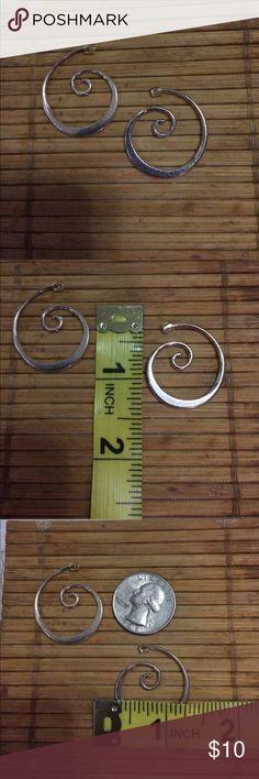 Silver swirl hoop earrings. Polished Silver earrings in a swirl pattern. Plastic backing posts. Jewelry Earrings