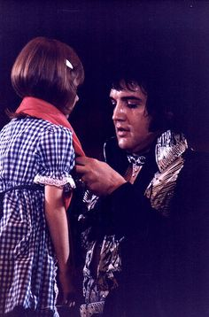 "gloriacicoria: "" During a concert in 1975 - Elvis was told that a blind girl was in the audience who absolutely loved him. Elvis told his entourage to bring the little lady on stage, immediately. The little lady got on stage, Elvis knelt before. King Elvis Presley, Elvis Presley Photos, Lisa Marie Presley, Priscilla Presley, Norfolk, Rock And Roll, Rare Elvis Photos, Are You Lonesome Tonight, Elvis In Concert"