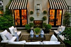 Love the awnings too - Decorating with Blue and White Outdoors- The Glam Pad