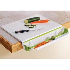 cutting board with collapsible scrap bin. Shut up and take my money! Kitchen Items, Kitchen Hacks, Kitchen Gadgets, Kitchen Tools, Kitchen Sale, Kitchen Things, Kitchen Stuff, Cooking Gadgets, Gadgets And Gizmos