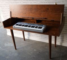 https://www.etsy.com/ca/listing/194320532/solid-cherry-piano-keyboard-table?ga_order=most_relevant