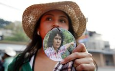 A woman shows a photo of slain environmentalist and indigenous leader and Berta Caceres outside the presidential office in Tegucigalpa, Honduras, Monday, May 9, 2016. (AP/Fernando Antonio)