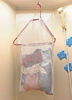 Laundry bag hung from bathroom ceiling (on a stud with a cup hook screwed in Travel Trailer Camping, Camping Car, Camping Ideas, Camping Hacks, Rv Hacks, Camping Stuff, Camping Survival, Outdoor Camping, Camping Organization