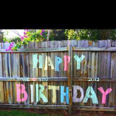 Easy, cheap, Birthday banner :) made with sidewalk chalk on my fence