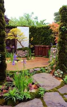 """This design is by Kazuyuki Ishihara, a Japanese designer who lifts greenery, floral design, and gardens to works of art. It's the Garden of Clouds, for which he was awarded a gold medal in the """"city garden"""" category at the Chelsea Garden Show in 2007."""