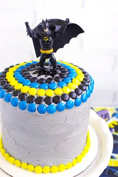 This year, Charlie's birthday cake request was for a Batman cake – so the two of us started brainstorming about what he wanted his cake to look like. The action figure on top was obviously the first thing we picked out and then we went from there. I ordered the Batman theme colored M&Ms he …