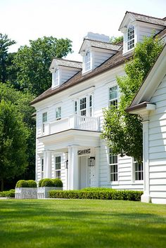 Classic white clapboard, simple landscaping