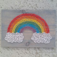 Custom string art rainbiw sign by Blossomingburlap on etsy