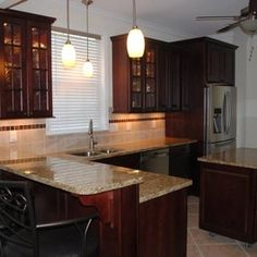 Kitchen Remodel with Maple Cabinets in Cranberry and NV Gold Granite by Hatchett Design/Remodel