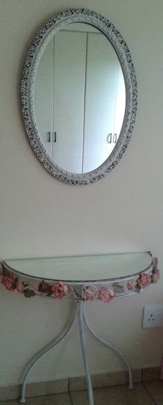 A table and an old mirror repurposed to be a dressing table