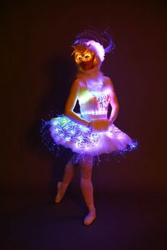 Ballerina of the future! Love this creative winter angel costume crafted with fiber optics and color morphing LED lights. Credit: LED Angels - Walkabout Characters in London.