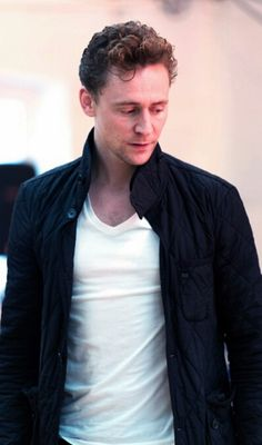 Tom Hiddleston looking away from the camera while thinking.... Of me.