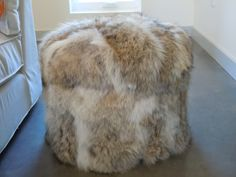 a fur pouf using recycled coat