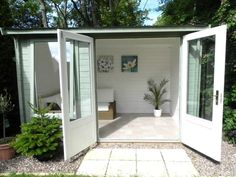 """We had to look twice at the David Weeks Carsare Log Cabin because it is so picturesque. The chosen decoration and theme makes this Log Cabin look so bright and inviting - perfect for garden parties in the summer! """"I couldn't be happier with my Summerhouse I purchased from Dunster House. The build was easy and it went up in no time. We've decorated it inside and out, Very happy!"""""""