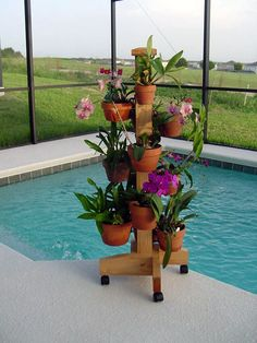 OMG.... I am going to use an old coat rack and add the pots with the hang a pots! www.hangapot.com