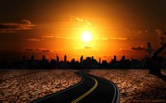 Lonely road heading to a dark city and a vivid orange sunset      http://theburningelements.com/sunset