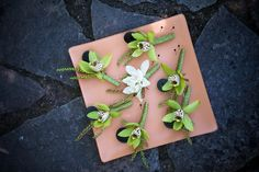 Green cymbidium orchid #boutonnieres for the fellas! {GB Photographers}