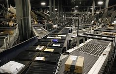 #parcels make their way along some of #ups Worldport's 155 miles of conveyor belts in Louisville, Kentucky, USA