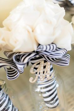 Black-and-White-Striped Ribbon Wrapped Bouquets | Lori Douglas Photography https://www.theknot.com/marketplace/lori-douglas-photography-kitty-hawk-nc-877171