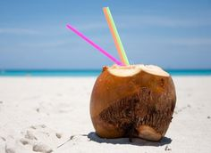 Coconut refreshment on the beach. Let www.grandturizmo.com send you on your dream vacation at the best price.