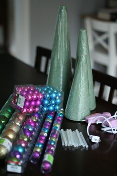Christmas ornament tree..  ( I would suggest though purchasing the balls at the dollar store.. and starting at the base mayb and working up and using the smaller balls as filler balls.. Or starting with the larger balls and working up in size.. and maybe if to much gaps filling with tinsel or glitter poms.. I think I will give it a try.)