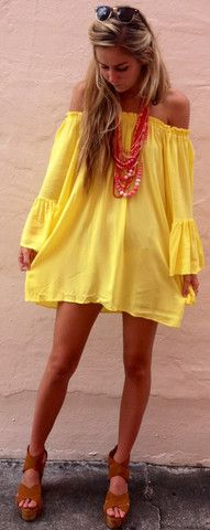 Yellow boho dress with a pink statement necklace and tan wedges.