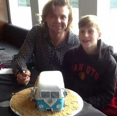 Ashton and Harry celebrating his birthday<that cake is so awesome