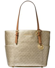 140b3f66e0dc Luxe hardware and elegant contours make MICHAEL Michael Kors' Jet Set Tote  in signature metallic