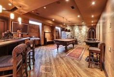 Rustic Game Room with Hardwood floors, High ceiling, Pendant Light, Carpet