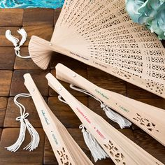 Intricately carved personalized Sandalwood fan favors from fashioncraft - Nice Price Favors