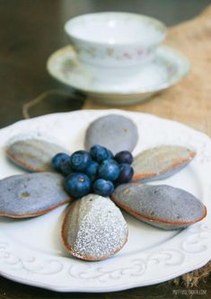 vbest moist blueberry madeleines; made with homemade sweet blueberry compote puree Madeleine Cake, Blueberry Compote, Frozen Blueberries, Powdered Sugar, Unsalted Butter, Melted Butter, Food To Make, Sweet Treats, Tea Cups