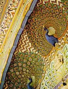 Ceiling of the Mashhad Mosque in Iran, decorated in multi-colored majolica in a peacock motif