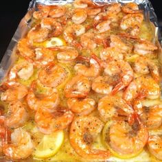 Lemon Butter Shrimp ~ Melt a stick of butter in pan Slice one lemon, layer on top of butter Put down fresh shrimp Sprinkle one pack of dried Italian seasoning Put in the oven and bake at 350 for 15 min Fish Recipes, Seafood Recipes, Great Recipes, Cooking Recipes, Favorite Recipes, Healthy Recipes, Healthy Foods, Recipies, Cajun Cooking