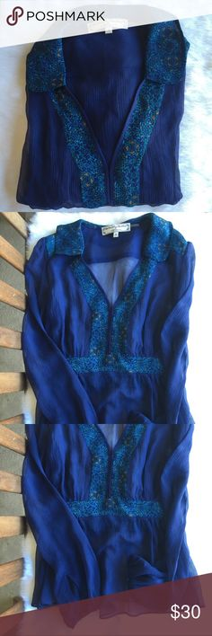 ➰ NEW LISTING ➰ Beautiful sheer blouse with a V neck opening. Closes with hooks and sleeves with a loop open button. Special detailed floral print on collar, shoulders and front. The middle is elastic, providing some stretch. Anthropologie Tops Blouses