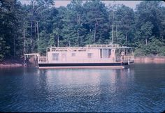 """Our Lazy Dayz houseboat on Lanier ~ mid-1960's ~ My Mama could dock this houseboat like nobody's business!! When we 1st got the boat, Daddy docked it the 1st time. He took out the power & water to the entire A Dock!!!! He never did it again :o) As soon as we reached our cove, he'd holler, """"NANCY!!!"""" and Mama did a great job. She became a master at it actually!! Skipper Nan ❤"""
