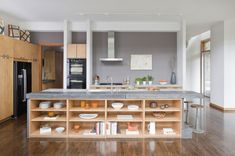 Before you start thinking about smart storage solutions and what range you want, decide what your island's main function is going to be. Most islands have a side devoted to cooking and a side devoted to eating, but what will your emphasis be? Prep work, cooking, cleaning, eating or entertaining? Or will you use it for everything, including homework and house projects?