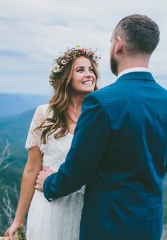 Achieve the ultimate boho look with a flower crown and a wedding gown that screams natural beauty!