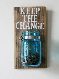 A mason jar mounted to painted wood — to collect odds and ends before they accidentally hit the wash. - Pin 'Em All: 8 Ingenious Ideas for Your Laundry Room
