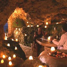 The Caves in Jamaica has a secluded grotto that you can reserve for a romantic dinner. How awesome!