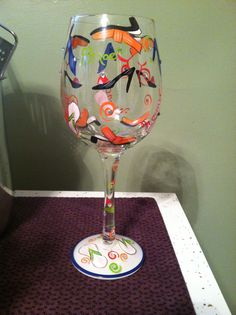 I love a cute, handpainted wine glass with shoes all over it!! #giftideas