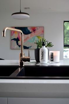 Black and white kitchen inspiration. Check out loads of photos from Gina's kitchen including matte black sink, copper tap, marble splashback and black cabinetry. She shares the design highlights and info on all the products >>