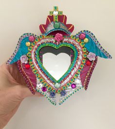 Mexican Sacred heart with wings and mirror tin nicho shadowbox shrine altar wall hanging by TheVirginRose on Etsy https://www.etsy.com/listing/546641965/mexican-sacred-heart-with-wings-and