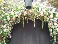 Beautiful trailing amaranthus, roses, , sweetpeas, Nigella, peoney and gypsophila arch to welcome your guests.