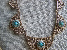 Check out this item in my Etsy shop https://www.etsy.com/listing/206185085/gold-bib-statement-turquoise-necklace