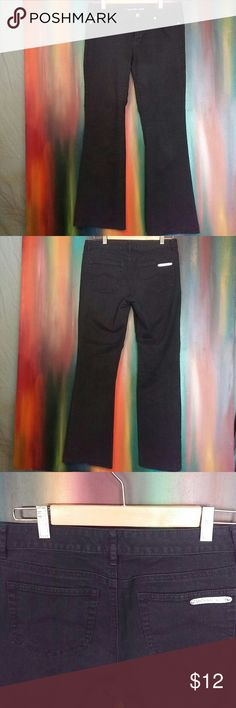 Michael Kors MK Jeans Black straight leg jeans. Made in China; Size 4; 99% cotton & 1 % spandex; good condition, very slight fading @ trims. Silver logo @ trim of back pocket. Pants are hemmed. Michael Kors Jeans Straight Leg